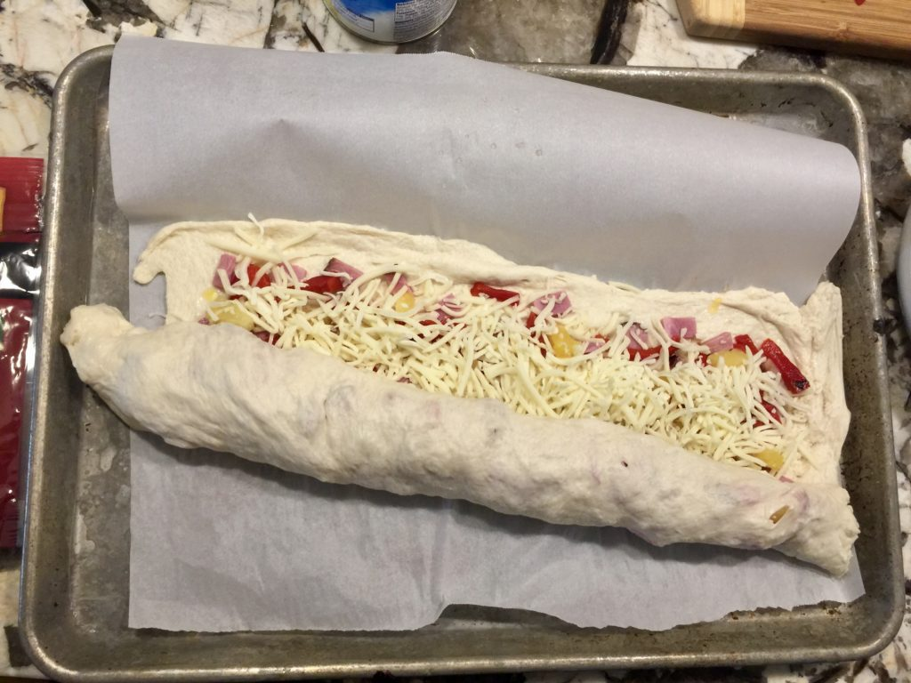 how to roll a stromboli
